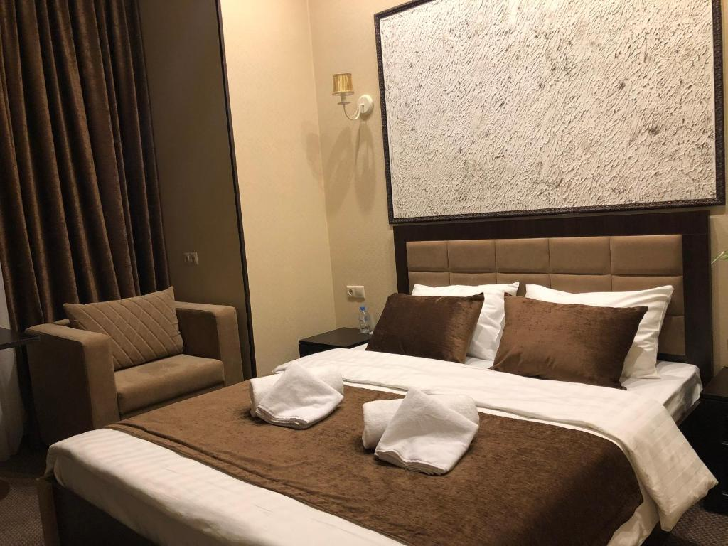 Кровать или кровати в номере Loro Hotel