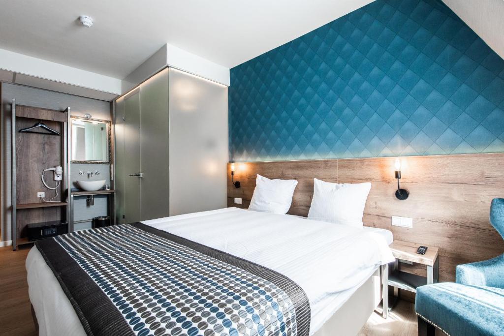 Cama ou camas em um quarto em Melrose Hotel