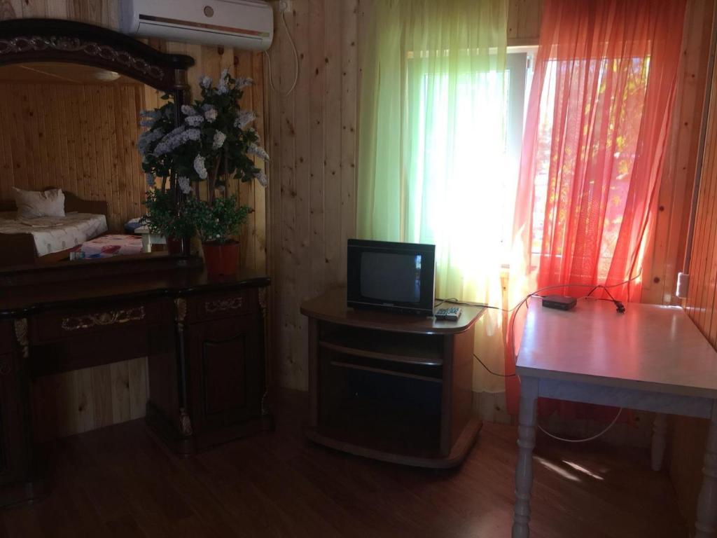Телевизор и/или развлекательный центр в Guest House Kristina