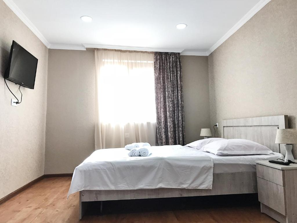 A bed or beds in a room at Apartment Erekle 6