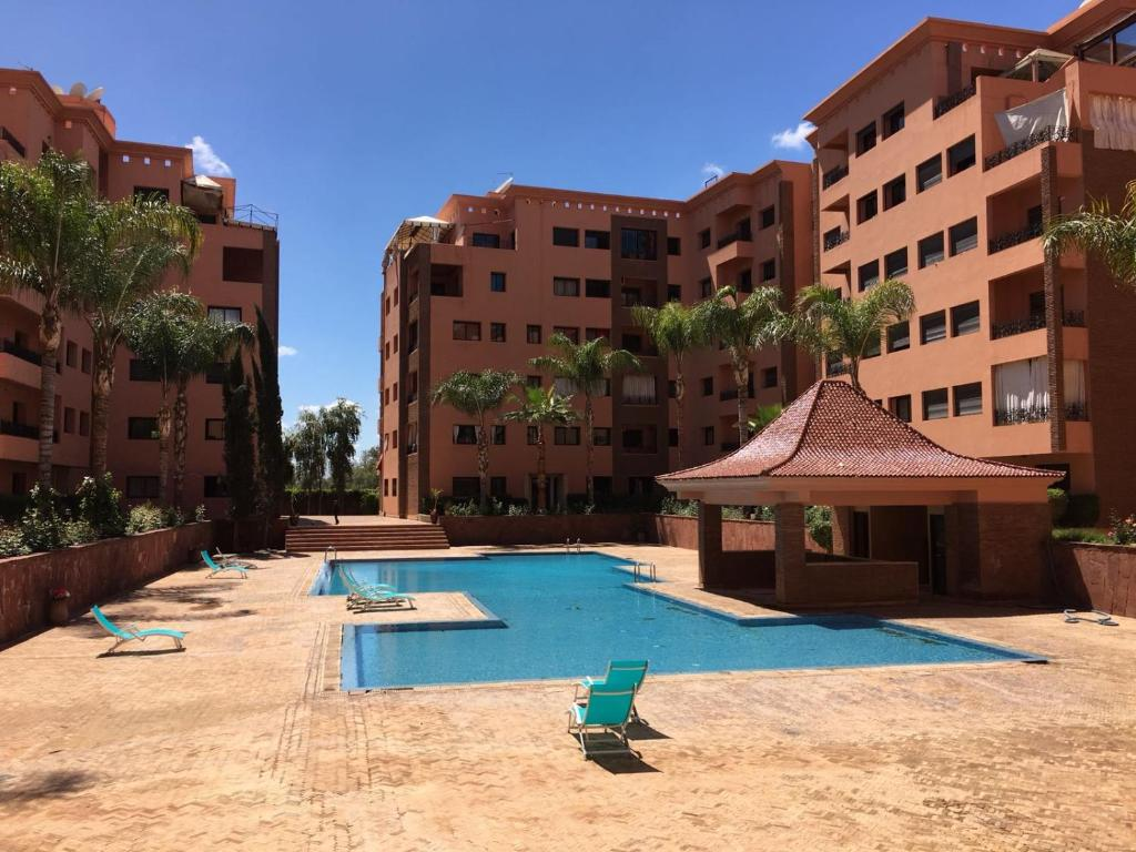 The swimming pool at or near Appartement la Residence Babylone