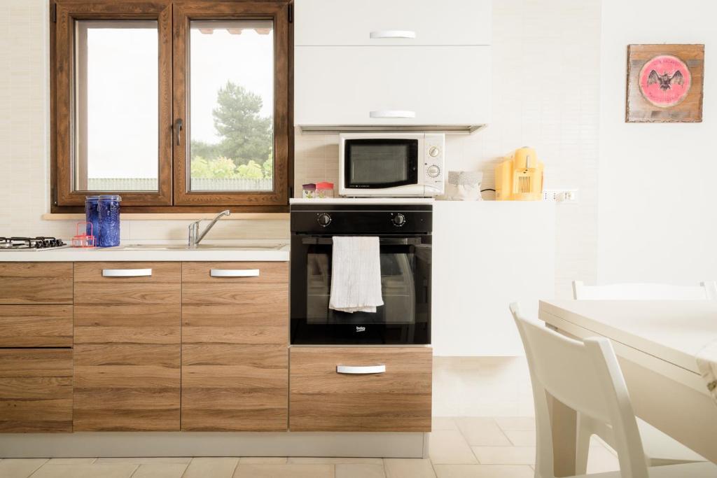 Cucina o angolo cottura di La Casetta Appartamenti