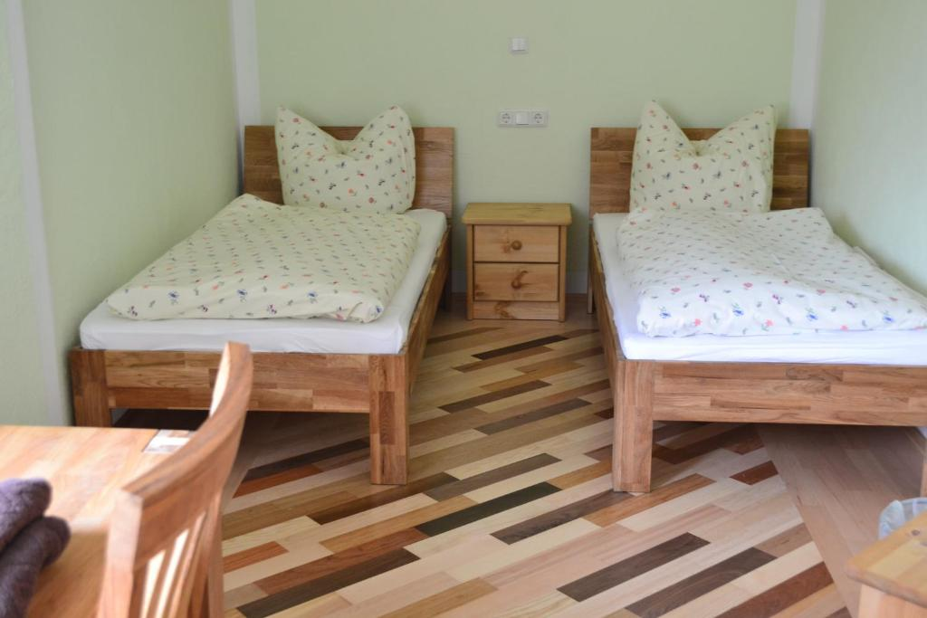 A bed or beds in a room at Pension - Hierzer