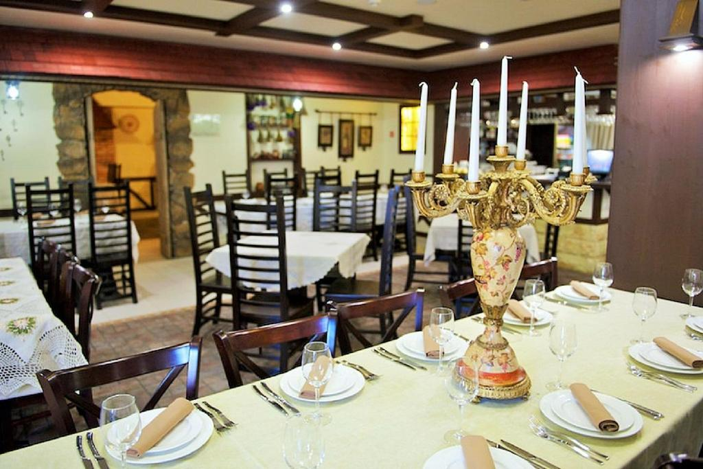 A restaurant or other place to eat at Аtria Hotel