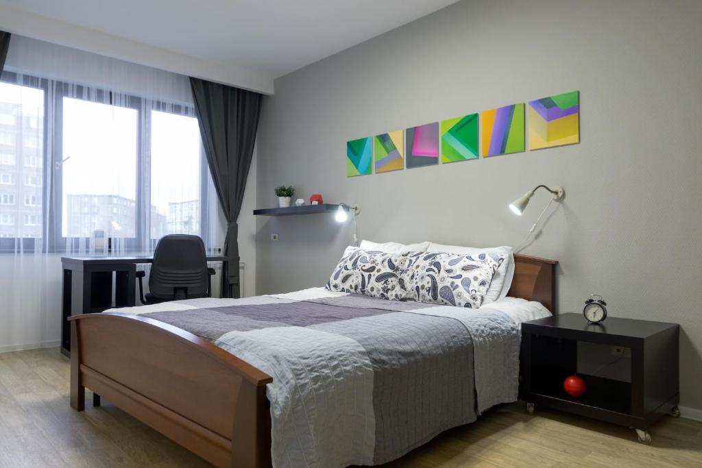 Кровать или кровати в номере Spacious apartments, 63m2, Murmansk