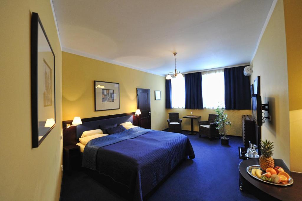 Postel nebo postele na pokoji v ubytování Hotel Arte