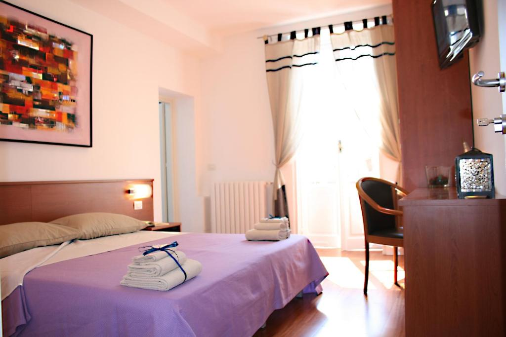 A bed or beds in a room at B&B Milano Bella