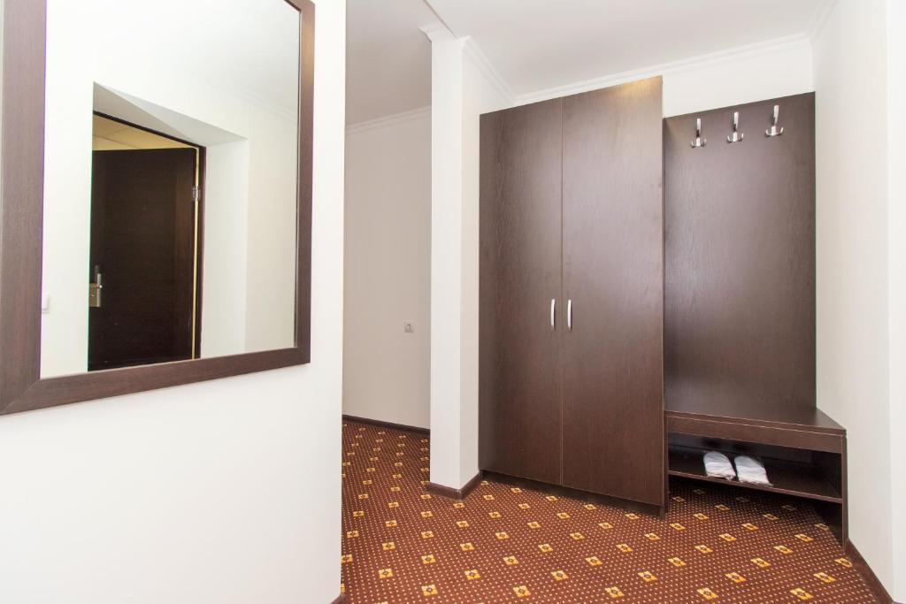 Телевизор и/или развлекательный центр в Отель Атрия