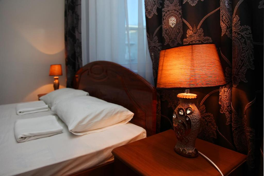 Кровать или кровати в номере Жемчужина Заречья