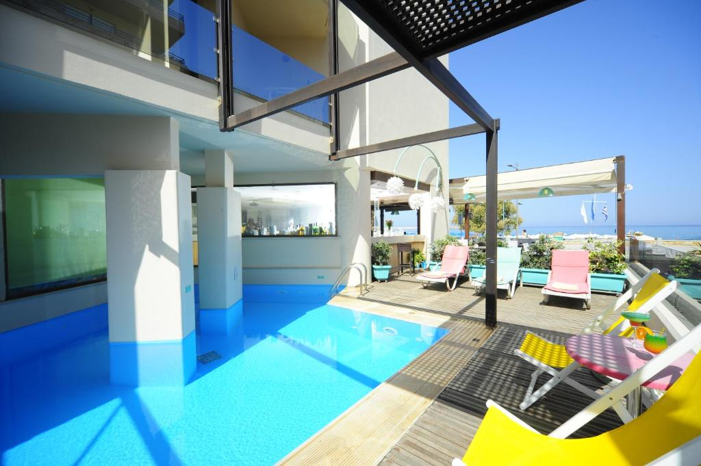 The swimming pool at or close to Steris Elegant Beach Hotel & Apartments