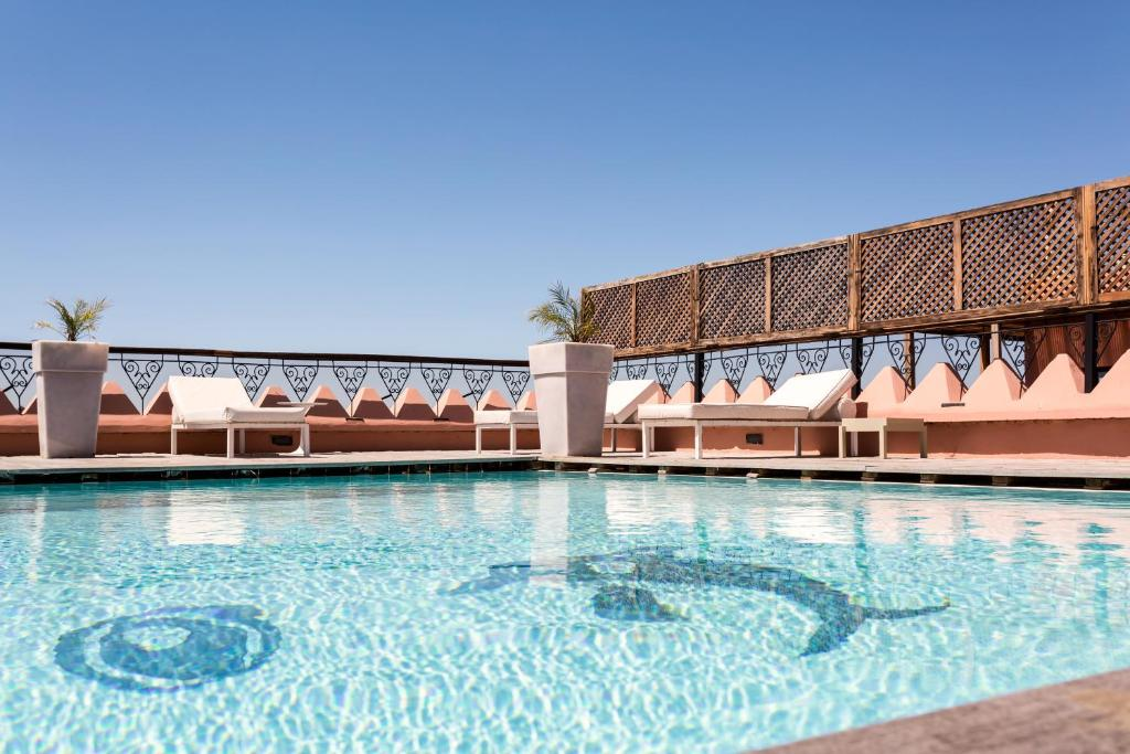 The swimming pool at or near 2 Bed Apartment, L'Hivernage, The Bardot, Rooftop Pool