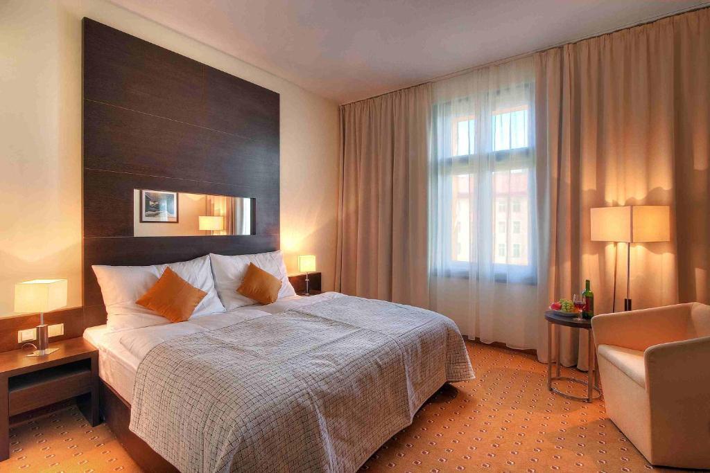 Кровать или кровати в номере Clarion Hotel Prague City
