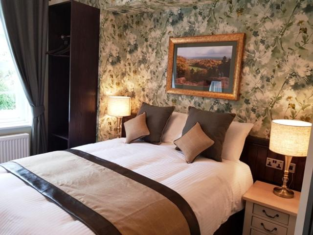 A bed or beds in a room at The Red Lion Inn