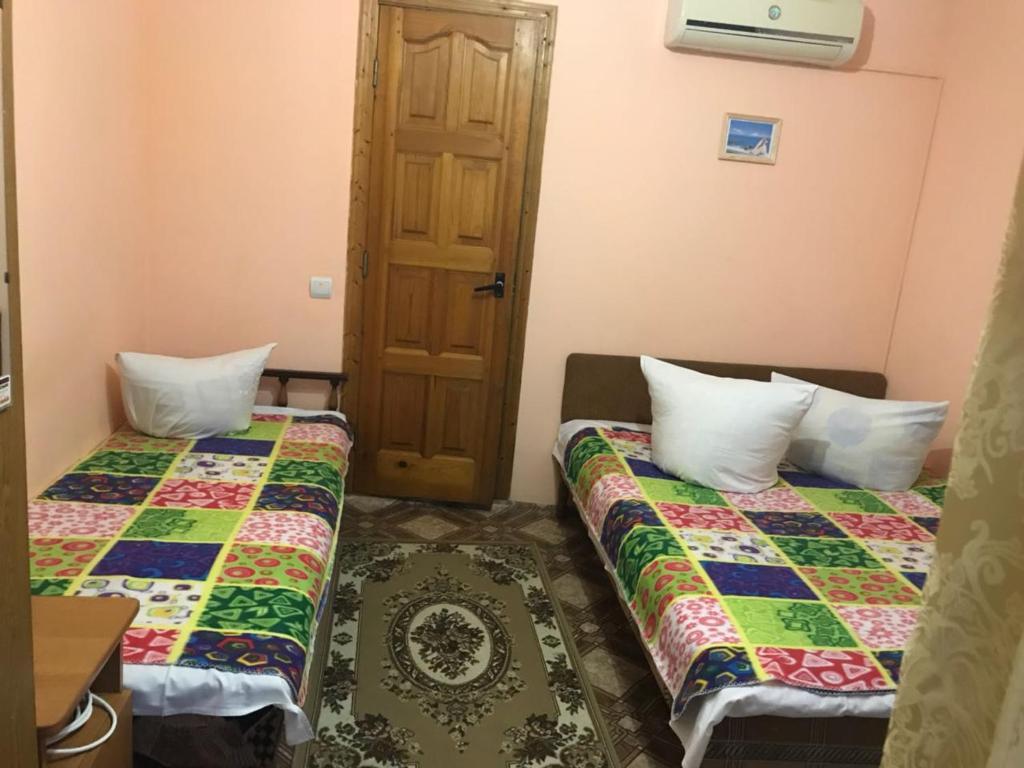 Кровать или кровати в номере Guest House Kristina