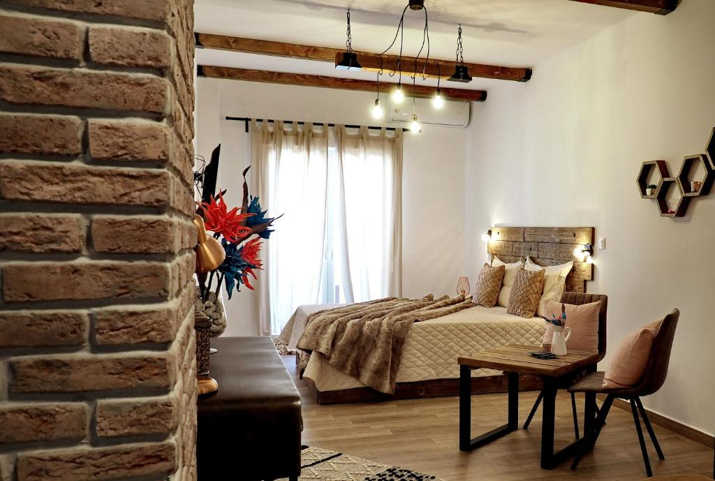 A bed or beds in a room at Homilis
