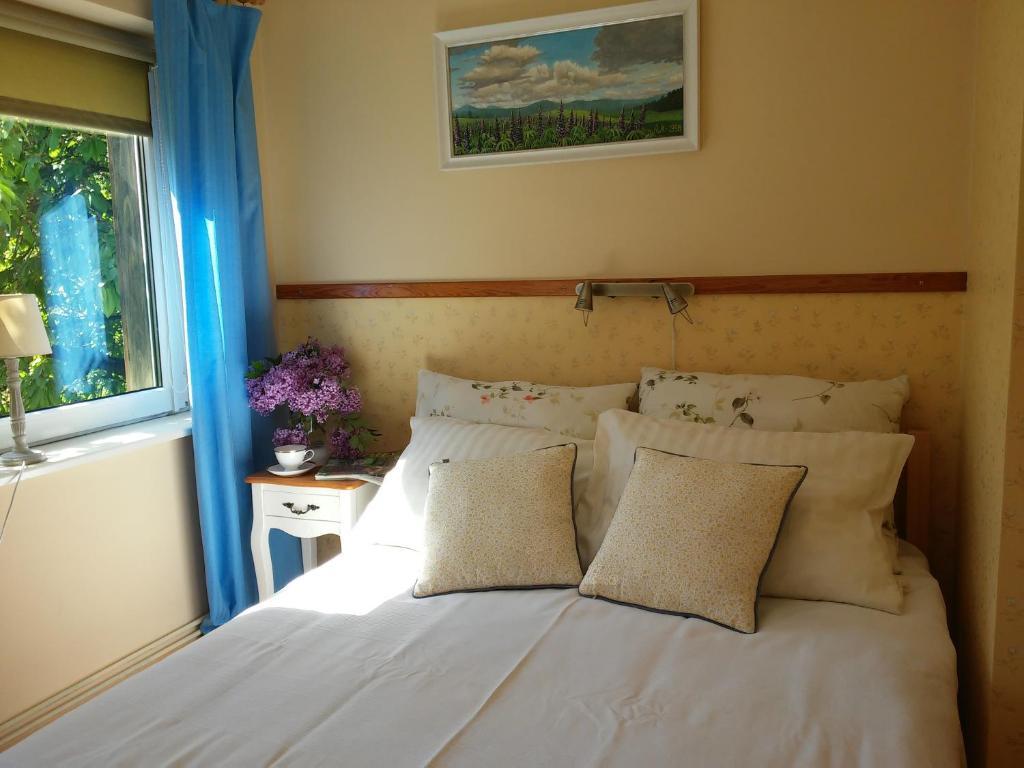 Łóżko lub łóżka w pokoju w obiekcie Żabi skok