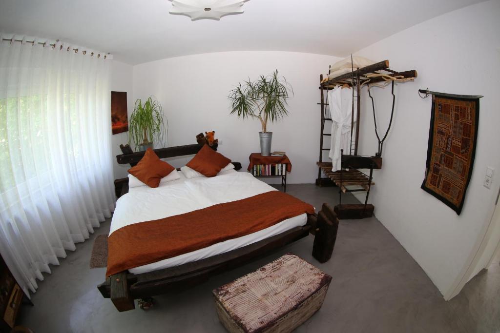 Ein Bett oder Betten in einem Zimmer der Unterkunft Avantgarde Living