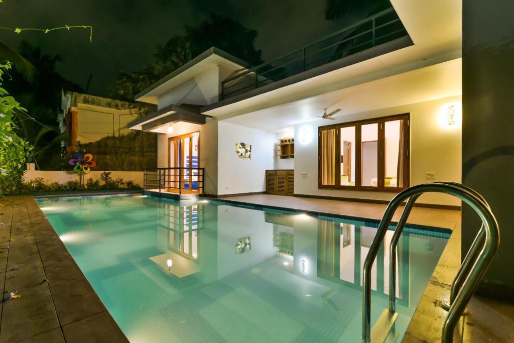 The swimming pool at or close to EKO STAY- CASA MIA VILLA