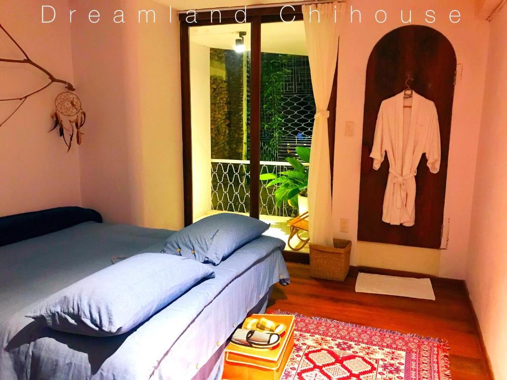 Giường trong phòng chung tại Dreamland - Chihouse