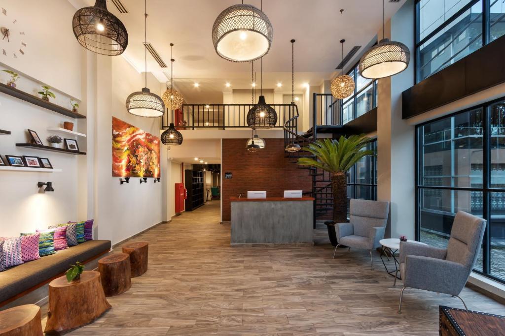 The lobby or reception area at S Loft Manado