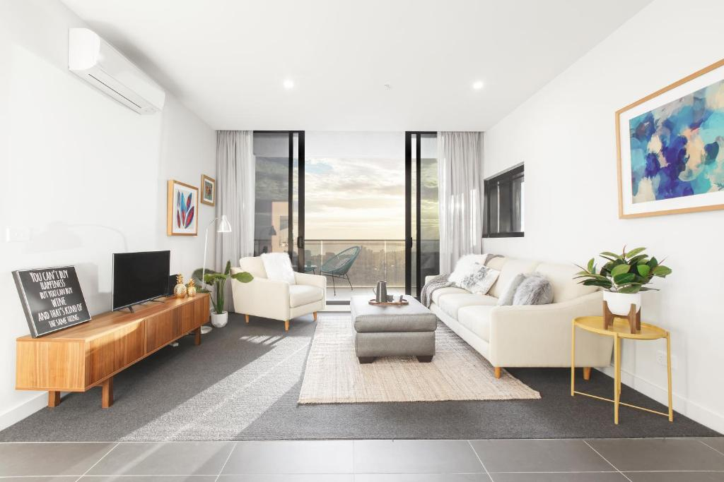 A seating area at Ascent Apartment with Ocean Views by Ready Set Host