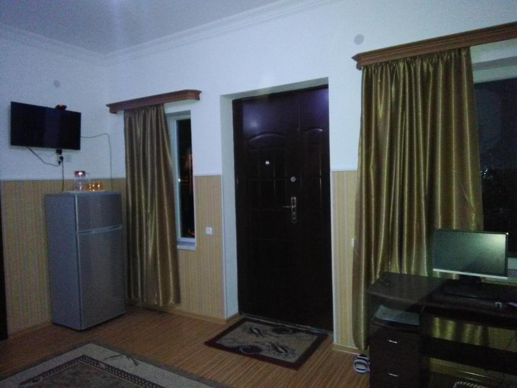 A television and/or entertainment center at Guest House Fazisi