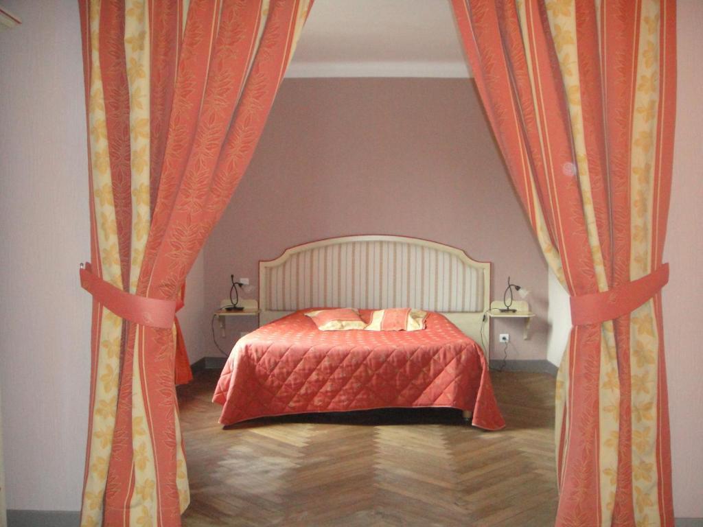Un ou plusieurs lits dans un hébergement de l'établissement Auberge des Lices