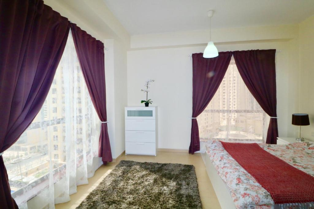 A bed or beds in a room at Two Bedroom Apartment - Bahar 4