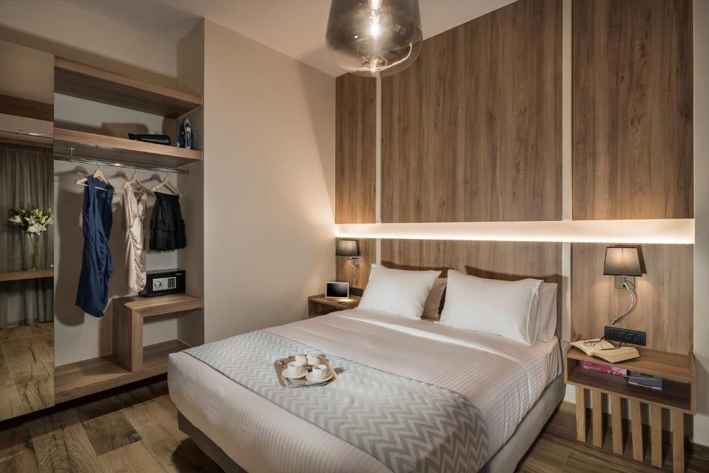 A bed or beds in a room at Sea & City Apartments