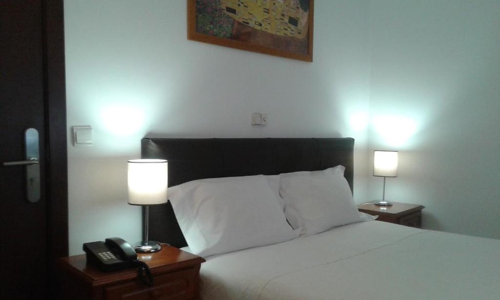 Uma cama ou camas num quarto em Hotel Tic Tac