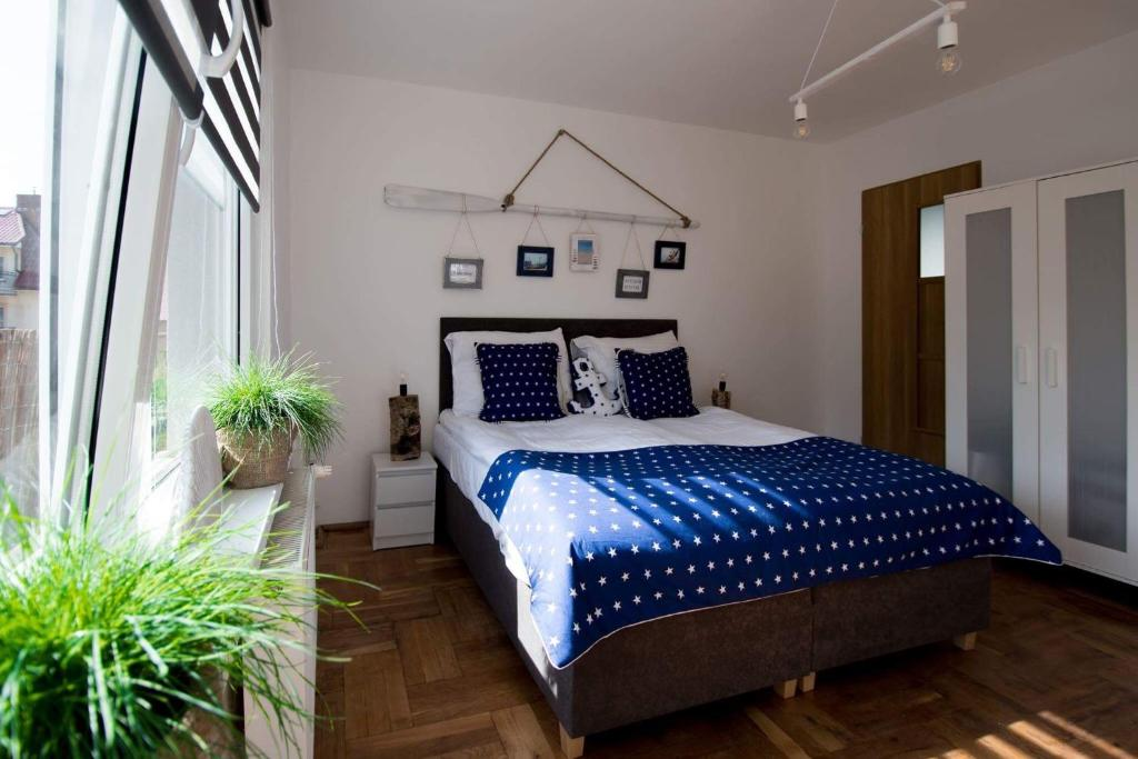Łóżko lub łóżka w pokoju w obiekcie U Miśków