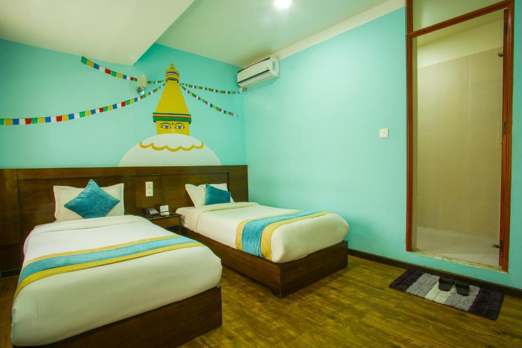 Кровать или кровати в номере Kathmandu Mantra Home