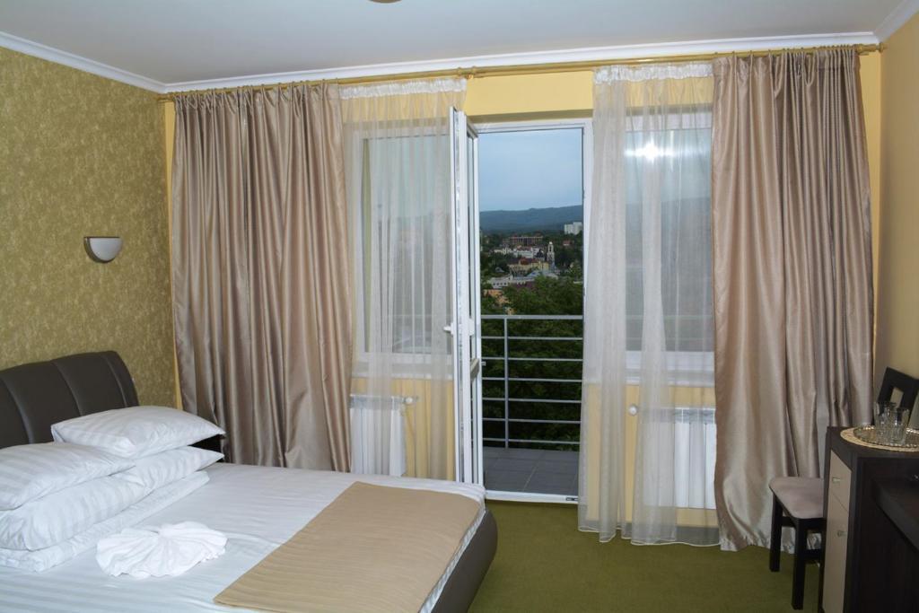 Ліжко або ліжка в номері Guest House at Lesya Ukrainka