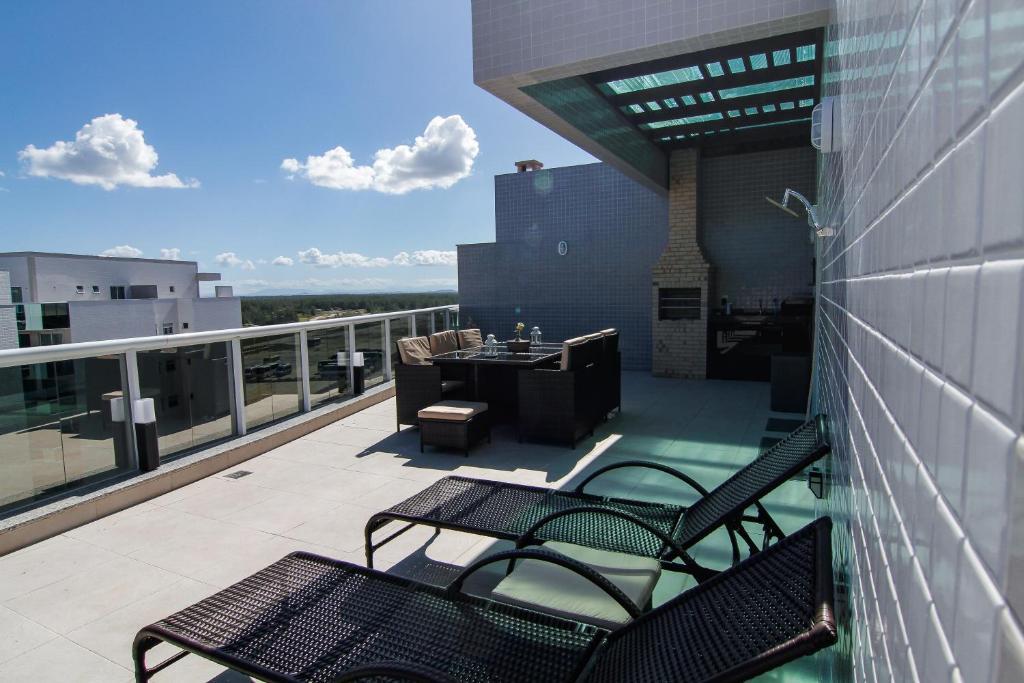 A balcony or terrace at Cobertura linear Le Bon Vivant