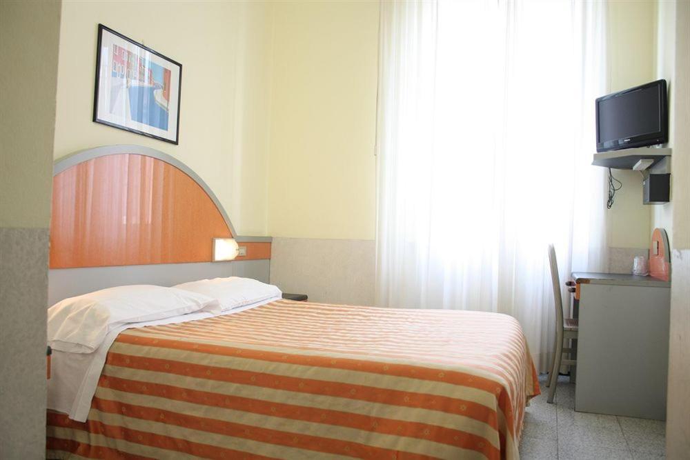 Letto o letti in una camera di Hotel Mazzini