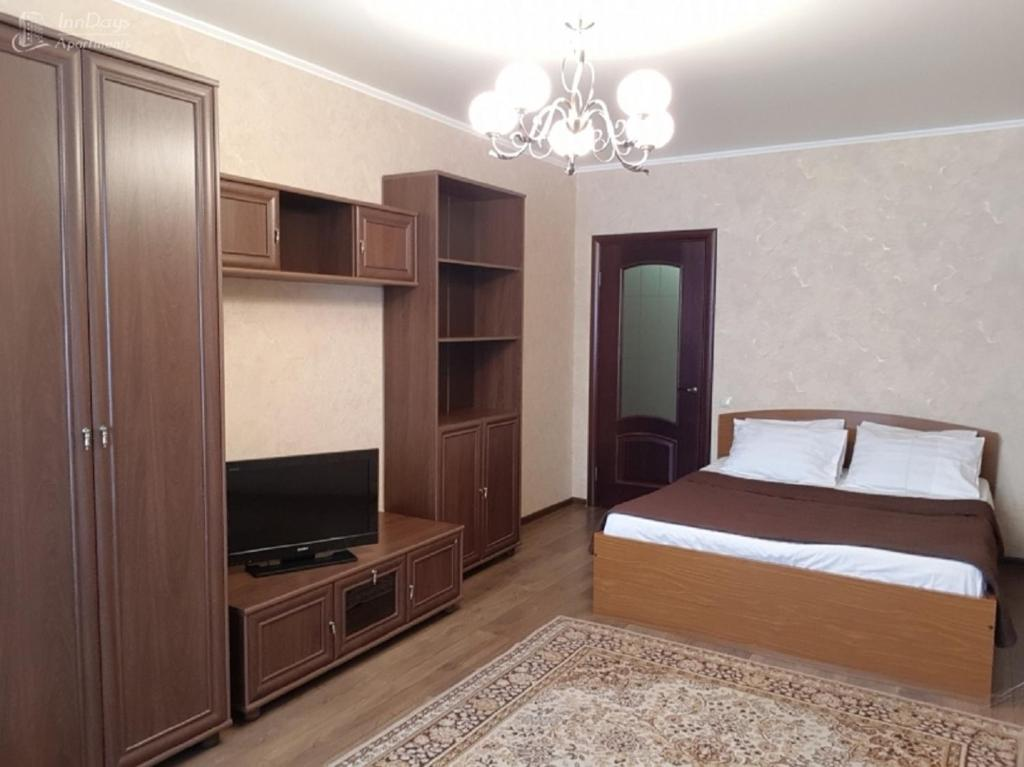 A bed or beds in a room at InnDays na Leningradskoy