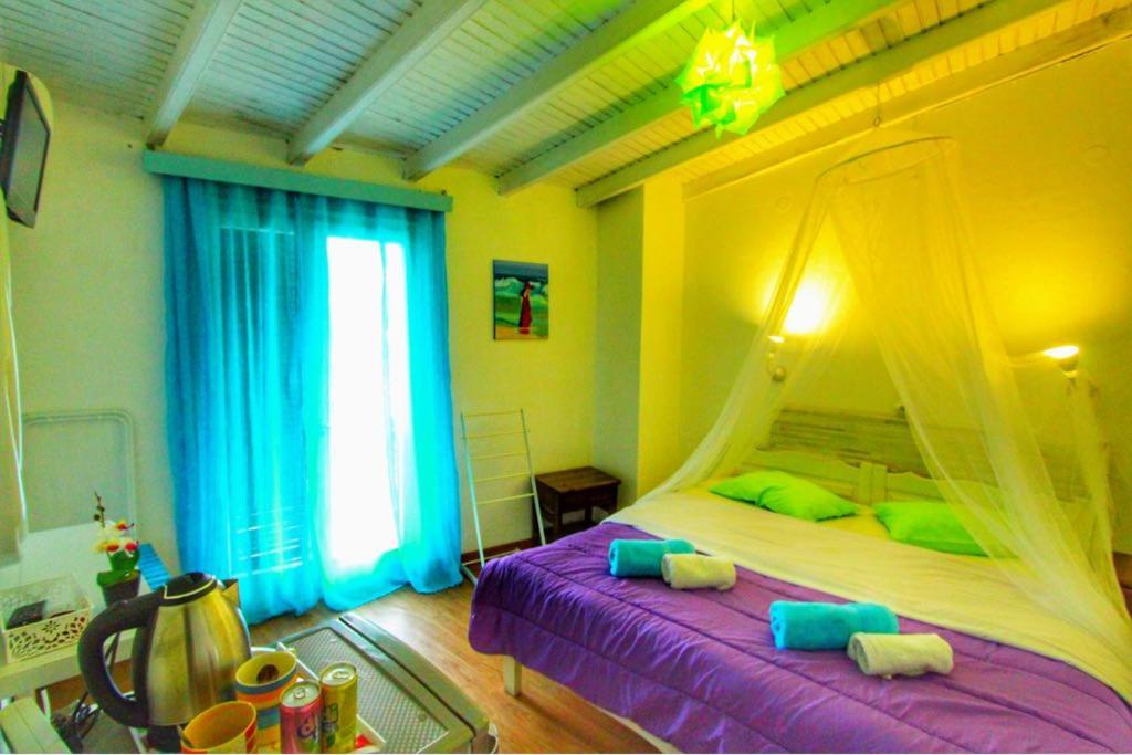 A bed or beds in a room at Avra Budget Beach Hotel