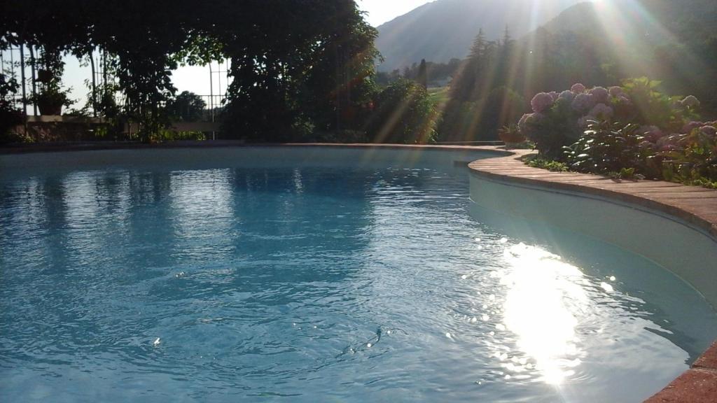 Het zwembad bij of vlak bij B&B POGGIO CAIAR