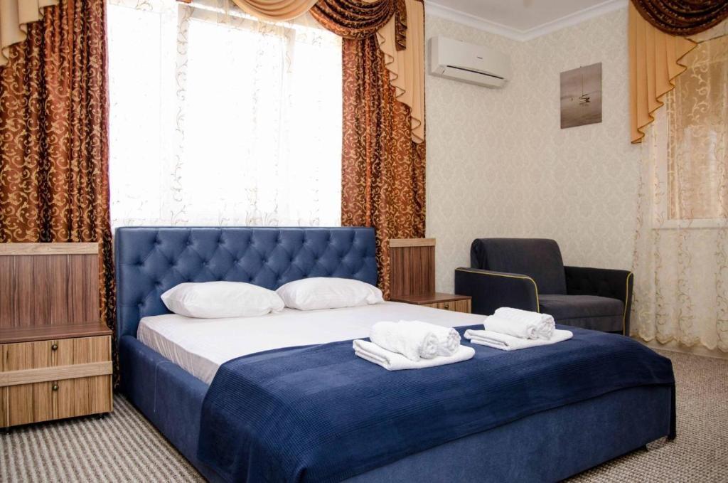 Кровать или кровати в номере Гостевой дом Олива