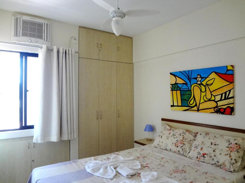 Cama ou camas em um quarto em Apartamento Ametista 2 + Bykes