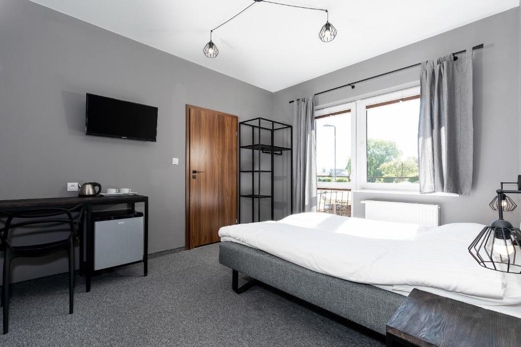 Łóżko lub łóżka w pokoju w obiekcie Pensjonat Kocius