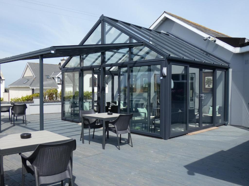 A restaurant or other place to eat at Coast Kilmore Quay Boutique Hotel