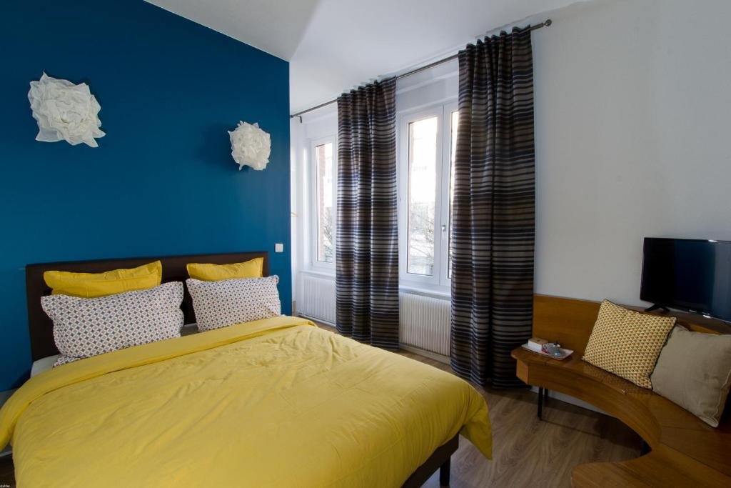 Ein Bett oder Betten in einem Zimmer der Unterkunft La Guesthouse chez Chris