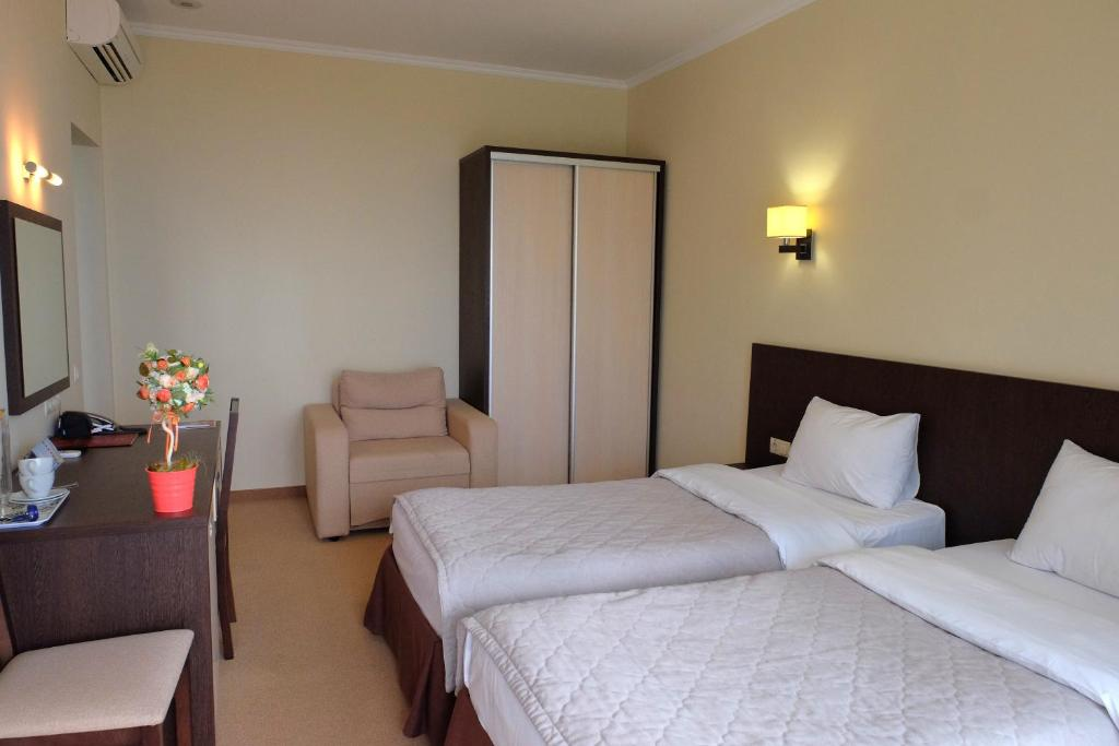 Кровать или кровати в номере Санаторий Актер