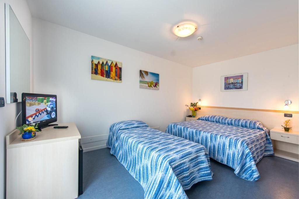 Postel nebo postele na pokoji v ubytování Hotel Minerva