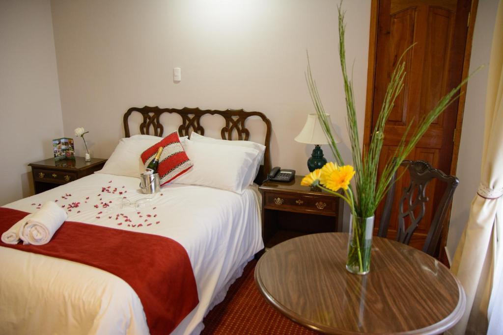 Cama o camas de una habitación en Hotel Boston Quillota