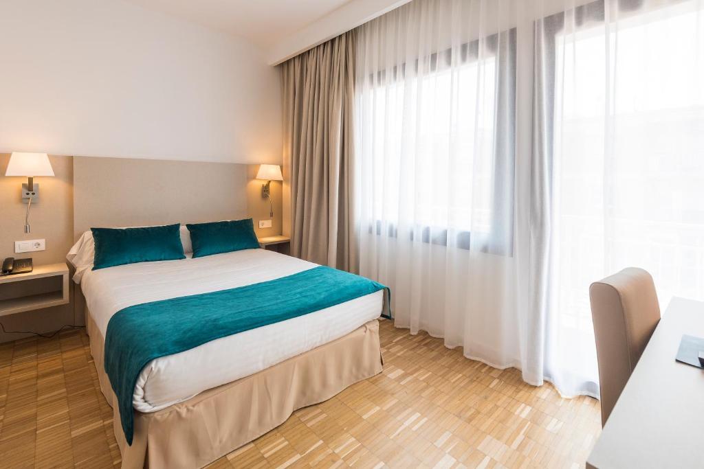 Cama o camas de una habitación en Hotel Lauria