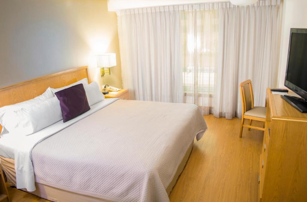 Кровать или кровати в номере iStay Hotel Monterrey Histórico