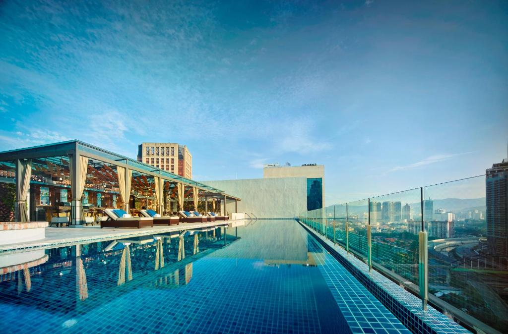 The swimming pool at or near Hotel Stripes Kuala Lumpur, Autograph Collection