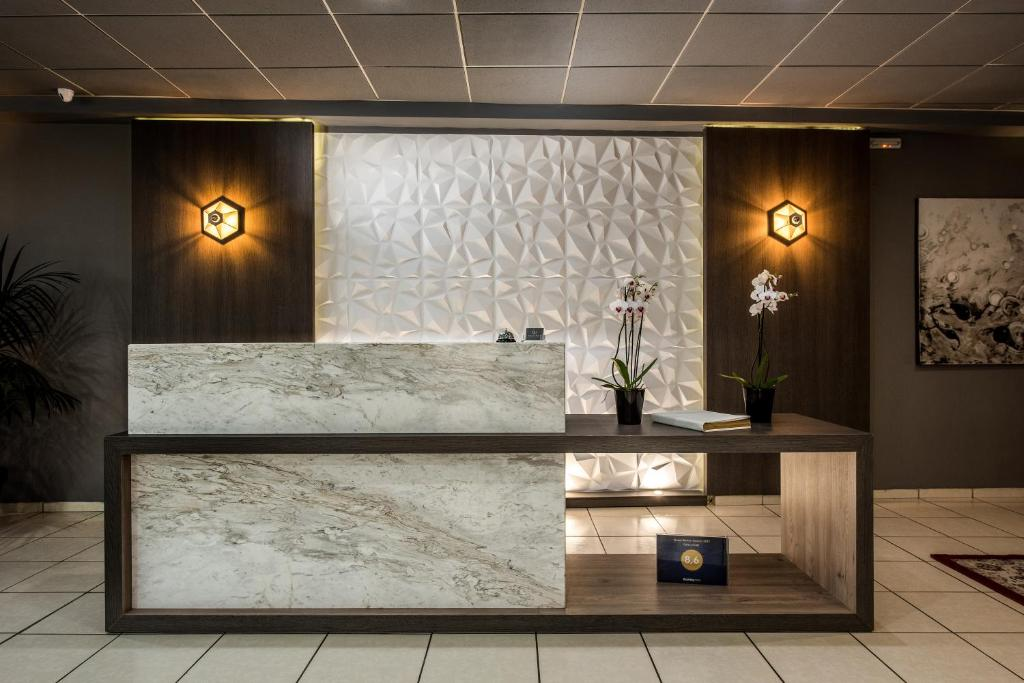 The lobby or reception area at Galaxy Hotel